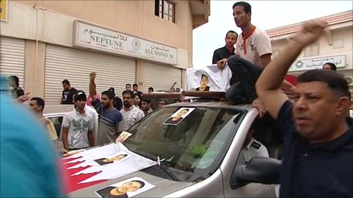Men protest at a funeral in Bahrain