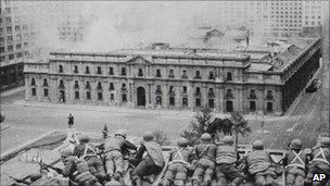 Soldiers supporting the coup led by Gen. Augusto Pinochet take cover as bombs are dropped on the Presidential Palace of La Moneda in this 11 Sept 1973 file photo