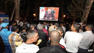 Algerians gather to watch President Bouteflika&#039;s speech on a giant screen in Telemcen, 15 April  