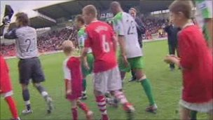 Wrexham and Kettering players and mascots