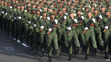 Cuban army cadets march, on April 16, 2011 in Havana, during the military parade to commemorate the 50th anniversary of the Bay of Pigs and the beginning of the Cuban Communist Party 6th Congress.