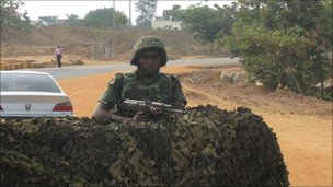 A soldier manning a checkpoint in Abuja