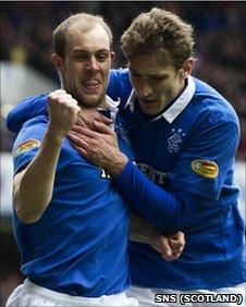 Steven Whittaker celebrates scoring a penalty for Rangers against St Mirren with team-mate Nikica Jelavic
