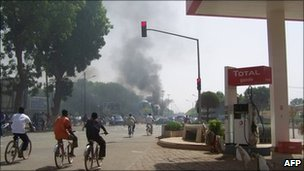 Smoke billows over Ouagadougou after traders riot in the Burkina Faso capital, 16 April