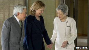 Japanese Emperor Akihito (L) and Empress Michiko (R) greet Hillary Clinton at the Imperial Palace in Tokyo on 17 April 2011