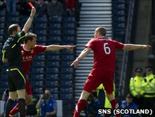 Aberdeen defender Considine is shown a red card by referee Willie Collum