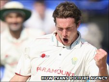 Glamorgan's Adam Shantry celebrates taking the wicket of Gloucestershire's Ian Saxelby