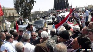 People gather during a demonstration in the Syrian city of Suwaida, April 17, 2011.