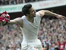 Arsenal striker Robin van Persie celebrates after his penalty against Liverpool
