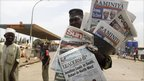 A newspaper vendor in Kaduna, Nigeria, 17 April