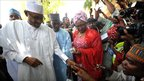 General Muhammadu Buhari registers before casting his voting in Daura, Nigeria, 16 April 2011