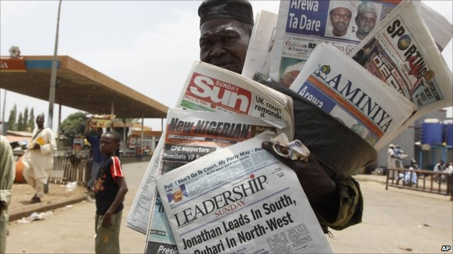 Man selling newspapers with election headlines in Kaduna, Nigeria, 17 April 2011