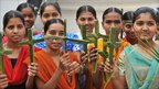 Indian Catholics hold blessed palms formed into crosses during a Palm Sunday procession at Saint Mary's Church in Secunderabad, 17 April 2011