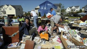 Residents of Raleigh in North Carolina searching through rubble