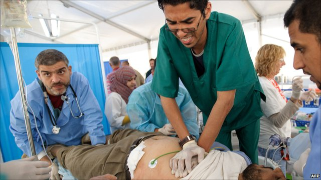 Doctors try to resuscitate a Libyan man wounded in fighting in Misrata, Libya.