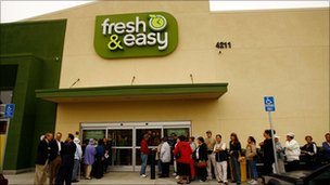 Shoppers queue outside a Tesco&#039;s Fresh &amp; Easy in Los Angeles
