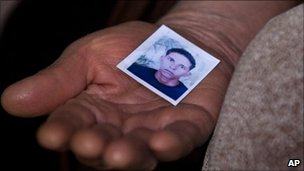 Mohamed Bouazizi's mother holds a photo of her late son in the town of Sidi Bouzid, Tunisia, 8 March