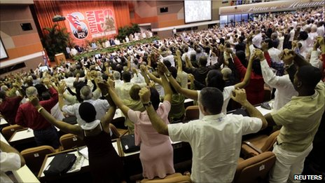 "Delegates sing ""The International"" at the end of the closing ceremony of the sixth Cuban Communist Party (PCC) Congress in Havana, 19 April, 2011"