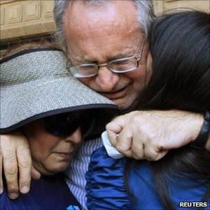 Mexican poet Javier Sicilia cries with family members in Cuernavaca, Mexico (1 April 2011)