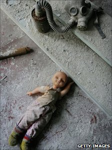 Doll and gas mask at an abandoned town