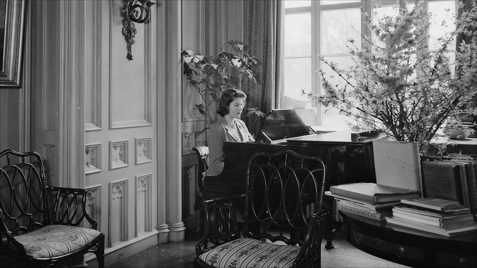 Princess Elizabeth plays the piano at the Royal Lodge in Windsor Castle, in April 1942.