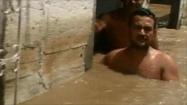 Man up to his chest in floodwater