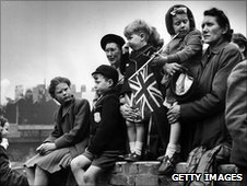 Families watching the Royal procession as King George VI goes to St Paul's to declare the Festival of Britain open