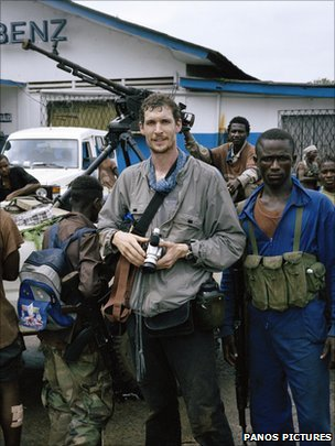 Tim Hetherington among rebel fighters of Liberians United for Reconciliation and Democracy (LURD) at their frontline headquarters in Tubmanberg, 2003