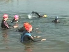 Members of the Outdoor Swimming Society in the Thames at Port Meadow