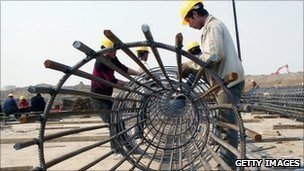 Labourers work at the Nanjing South Railway Station on 27 March 2011