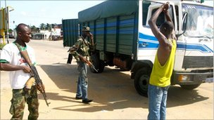 Abidjan residents are questioned at roadblocks as pro-Ouattara forces hunt for Mr Gbagbo's combatants