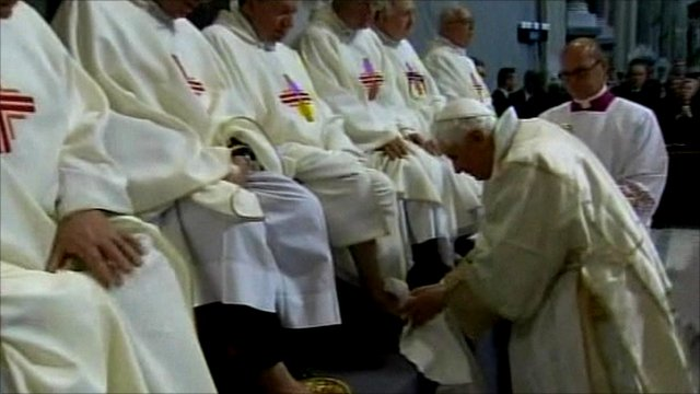 Pope washing the feet of priests