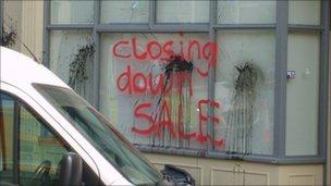 Closing down sale daubed on Tesco window