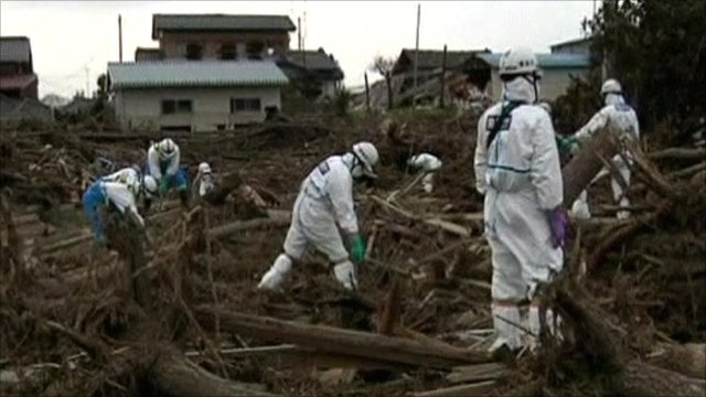 Workers clearing rubble in Japan