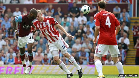 Darren Bent (left) heads Villa's equaliser