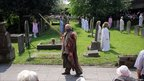 Nigel Barrett returns as the mysterious stranger who baptised Sheen's Christ-like figure