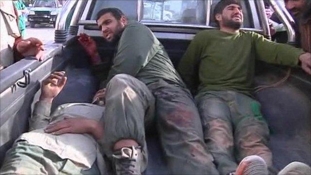 Gaddaffi forces in a rebel truck
