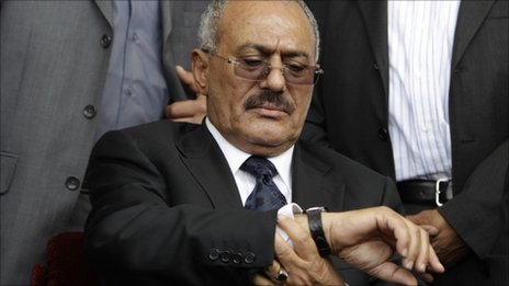 Yemeni President Ali Abdullah Saleh consults his watch at a rally in the capital Sanaa, 15 April