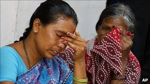 Devotees grieve on hearing the news of the Sai Baba's death, outside Baba's ashram in Puttaparthi April 24, 2011