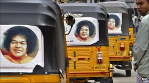 Rickshaws with pictures of Sathya Sai Baba, in Puttaparti, India, April 2011