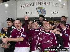 Arbroath players break out the champagne