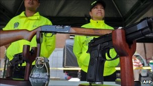 Weapons, seized from criminal gangs, are displayed at a square in Medellin, Antioquia Department, Colombia on March 18, 2011