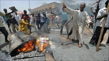 People demonstrate in Nigeria's northern city of Kano where running battles broke out between protesters and soldiers on April 18, 2011