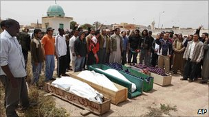 Mourners attend the funeral of a group of family members killed by shelling in Misrata, Libya, 25 April