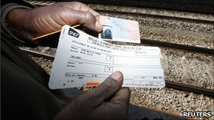 Tunisian migrant shows Italian travel documents