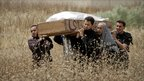Mourners carry a coffin in Misrata, Libya