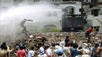 Police fire water cannon in Taiz, Yemen