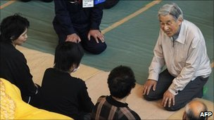 Japan's Emperor Akihito talks to people in a shelter in Minamisanriku on 27 April 2011