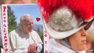 A supporter holds a picture of Pope John Paul II ahead of the beatification ceremony
