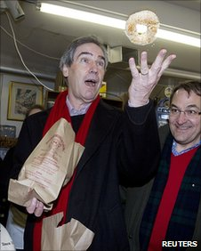 Michael Ignatieff throws a bagel in the air